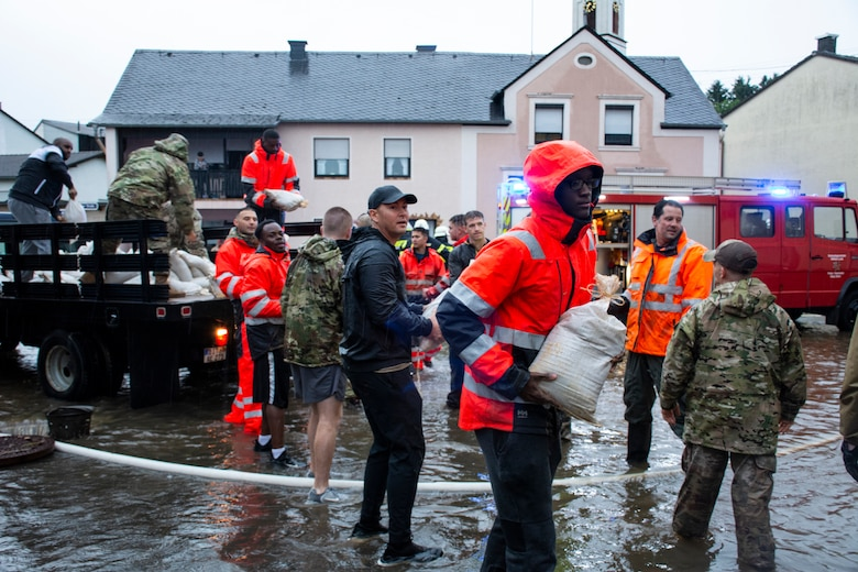 Members from the 52nd Civil Engineer Squadron from Spangdahlem Air Base, Germany, work with German first responders and community members to deliver sandbags to the town of Binsfeld, Germany, July 14, 2021.