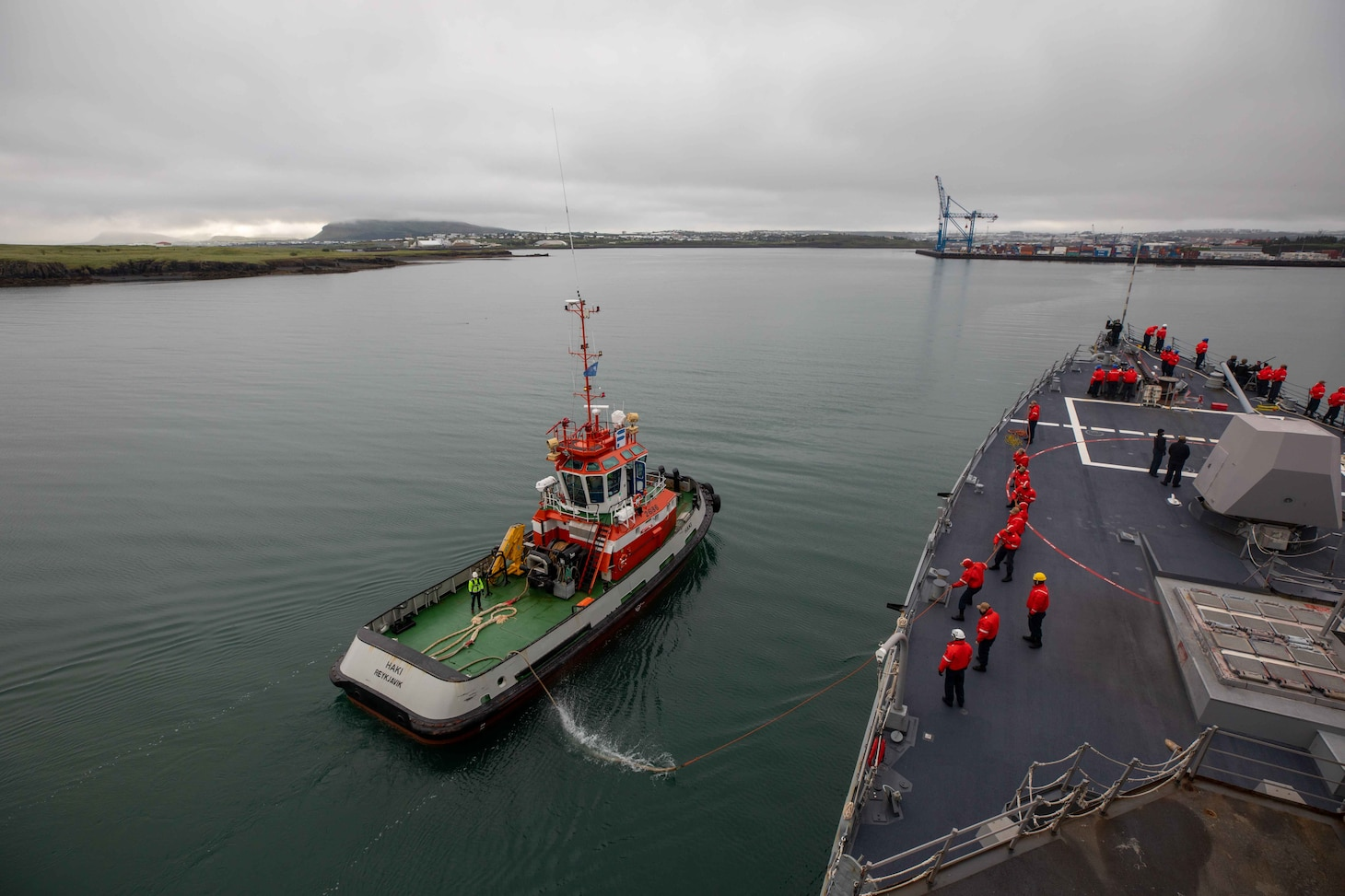 (July 18, 2021) Sailors aboard the Arleigh Burke-class guided-missile destroyer USS Roosevelt (DDG 80) handle line from a tugboat, July 18, 2021. Roosevelt, forward-deployed to Rota, Spain, is on its second patrol in the U.S. Sixth Fleet area of operations in support of regional allies and partners and U.S. national security interests in Europe and Africa.