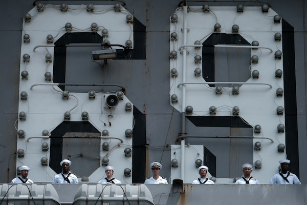 Sailors man the rails as the Nimitz-class aircraft carrier USS Dwight D. Eisenhower (CVN 69) returns to Naval Station Norfolk, July 18. Eisenhower returned to homeport after a regularly scheduled deployment.