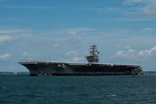 The Nimitz-class aircraft carrier USS Dwight D. Eisenhower (CVN 69) returns to Naval Station Norfolk, July 18.