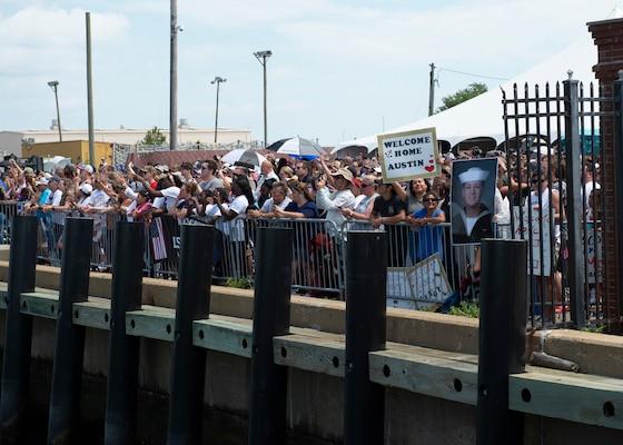 Families await the arrival of their loved ones as Nimitz-class aircraft carrier USS Dwight D. Eisenhower (CVN 69) returns to Naval Station Norfolk, July 18.