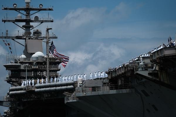 Sailors man the rails as the Nimitz-class aircraft carrier USS Dwight D. Eisenhower (CVN 69) returns to Naval Station Norfolk, July 18.