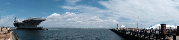 Families greet the ship as the Nimitz-class aircraft carrier USS Dwight D. Eisenhower (CVN 69) returns to Naval Station Norfolk, July 18.