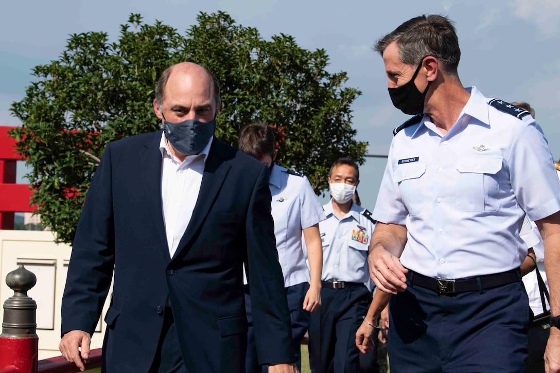 U.K. Secretary of State for Defence Ben Wallace and Lt. Gen. Kevin Schneider, U.S. Forces Japan and 5th Air Force commander, talk while leaving the flightline at Yokota Air Base, Japan, July 19, 2021.