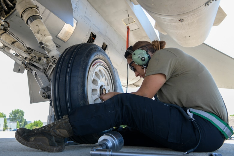 Senior Airman Brooke Parks, 555th Aircraft Maintenance Unit F-16 Fighting Falcon crew chief, changes a tire on a U.S. Air Force F-16 during exercise Thracian Star 21 at Graf Ignatievo Air Base, Bulgaria, July 9, 2021. As a crew chief, Parks services, inspects, refuels, changes tires, and performs heavy maintenance on F-16s. (U.S. Air Force photo by Airman 1st Class Brooke Moeder)