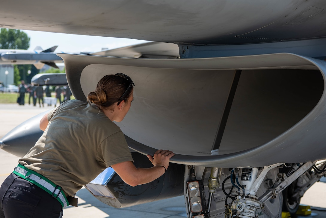 Senior Airman Brooke Parks, 555th Aircraft Maintenance Unit F-16 Fighting Falcon crew chief, inspects the intake of a U.S. Air Force F-16 during exercise Thracian Star 21 at Graf Ignatievo Air Base, Bulgaria, July 9, 2021. Out of 61 total crew chiefs in the 555th AMU, Parks is the only female crew chief who works on the flightline. (U.S. Air Force photo by Airman 1st Class Brooke Moeder)