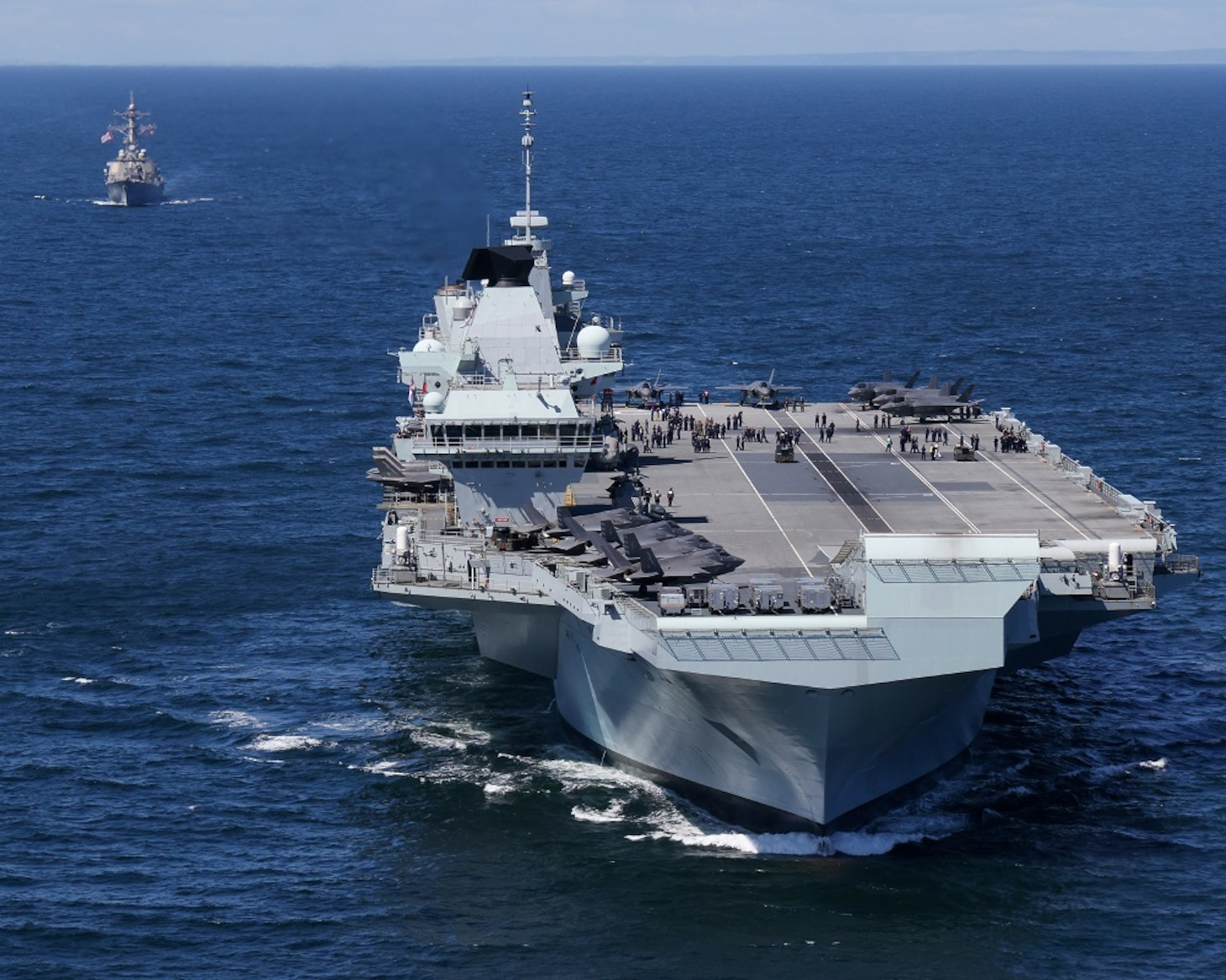 HMS Prince of Wales and HMS Queen Elizabeth pictured at sea for the first time with USS The Sullivans.