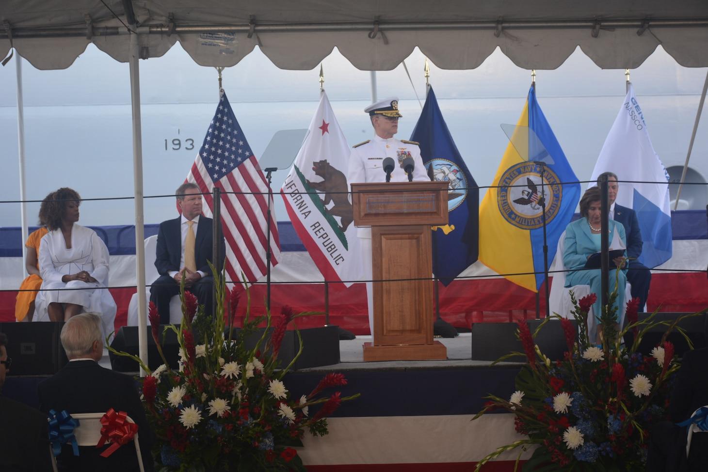 Rear Adm. Michael Wettlaufer, Commander, Military Sealift Command, speaks during the christening ceremony of the fleet replenishment oiler USNS John Lewis.