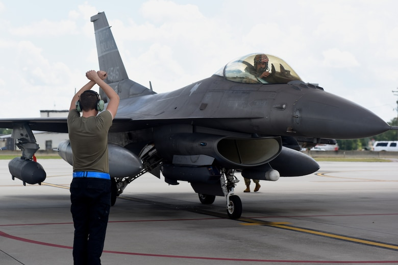 """U.S. Air Force personnel recently deployed to Prince Sultan Air Base, Kingdom of Saudi Arabia, return home July 16, 2021 to the 169th Fighter Wing at McEntire Joint National Guard Base, South Carolina. """"Swamp Fox"""" Airmen from the South Carolina Air National Guard's 169th Fighter Wing were deployed to PSAB for the past three months to project combat power and help bolster defensive capabilities against potential threats in the region. (U.S. Air National Guard photo by Senior Airman Mackenzie Bacalzo, 169th Fighter Wing Public Affairs)"""