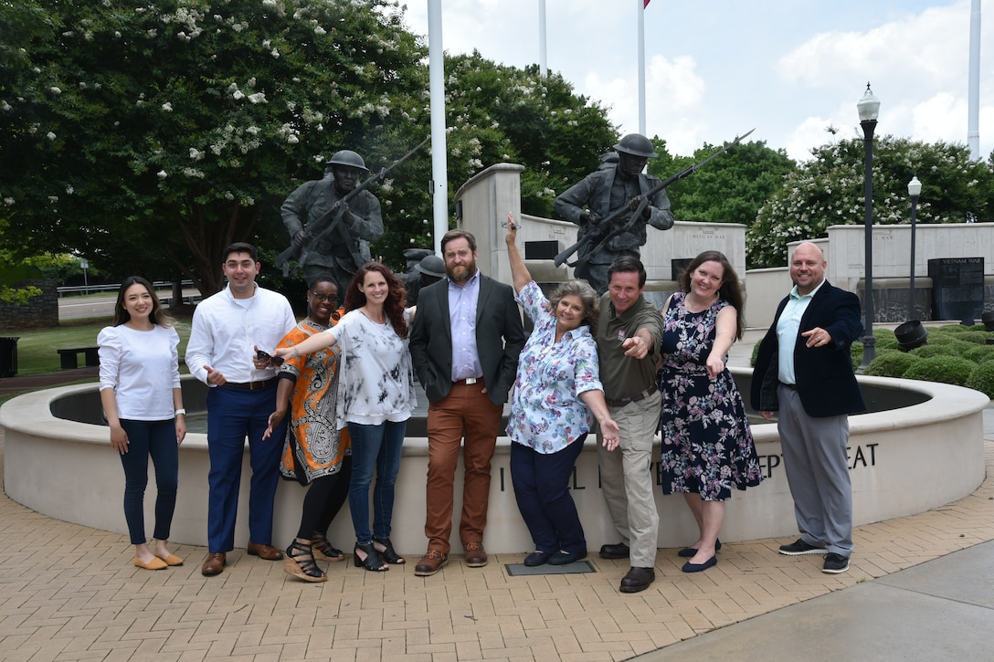 """Members of Huntsville Center's Resource Management Directorate's Business Practices Division team pose for a photograph at the Huntsville Madison County Veterans Memorial. Members are Mary Hinson, Brian Tachias, Carolyn Harris, Amanda Odem, John Dodson, Angela Rackard, Russ Dunford, Susan Armstrong, James """"Jimmy"""" Johnson. The team was recognized with the 2021 U.S. Army Corps of Engineers Innovation of the Year Award."""