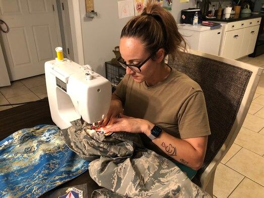 woman sewing uniforms