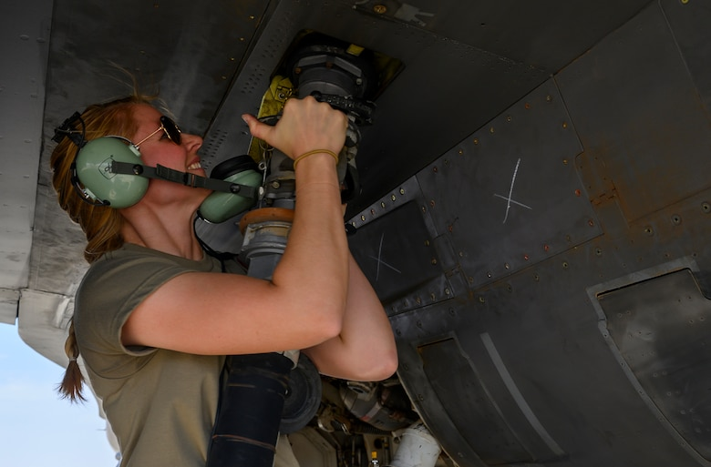 U.S. Air Force Staff Sgt. Rebecca Sumpter, 157th Expeditionary Fighter Generation Squadron weapons load crew, attaches the fuel hose to a U.S. Air Force Fighting Falcon F-16 during a counter unmanned aerial system integration mission with joint and Royal Saudi aircraft at a forward location in the Kingdom of Saudi Arabia, June 30, 2021. U.S. Air Forces Central aircraft regularly work with coalition and partner nations to test their collective counter-UAS capabilities to ensure the security and stability of regional airspace. (U.S. Air Force photo by Senior Airman Samuel Earick)