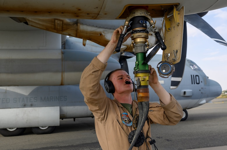 A U.S. Marine with Marine Aerial Refueler Transport Squadron 352, assigned to Special Purpose Marine Air-Ground Task Force – Crisis Response – Central Command, connects a fuel hose to a U.S. Marine Corps KC-130J Hercules during a counter unmanned aerial system integration mission with joint and Royal Saudi aircraft at a forward location in the Kingdom of Saudi Arabia, June 30, 2021. U.S. Air Forces Central aircraft regularly work with coalition and partner nations to test their collective counter-UAS capabilities to ensure the security and stability of regional airspace. (U.S. Air Force photo by Senior Airman Samuel Earick)