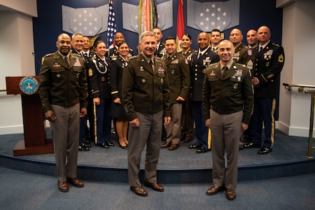 Group of men and women pose for a photo.