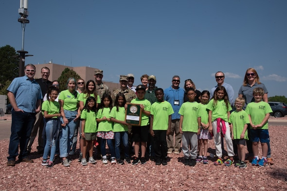 Members of the 21st Mission Support Group, 21st Civil Engineer Squadron and the R.P. Lee Youth Center are presented the Tree City USA award by the Colorado State Forest Service on Peterson AFB, Colorado, July 15, 2021. Peterson Air Force Base has received the award 27 times since 1993 and holds an annual Arbor Day ceremony celebrating participation in the Tree City USA program. (U.S. Space force photo by Airman Aaron Edwards)