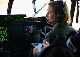 a woman flies a plane
