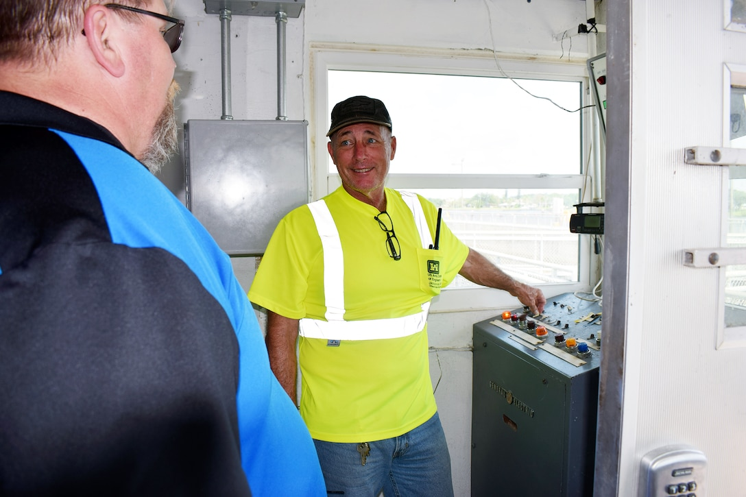Jacksonville District lock operator Glenn Hutson, opens the lock chambers northbound and southbound from the control gate access room. Pictured (left) William Keeney, supervisory lock operator U.S. Army Corps of Engineers Jacksonville District (right) Glenn Huston.
