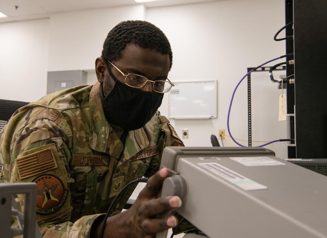 Staff Sgt. Dantes Johnson, 56th Component Maintenance Squadron precision measurement equipment lab technician, calibrates a frequency counter July 1, 2021, at Luke Air Force Base, Arizona. Frequency counters measure the number of cycles of oscillation, or pulses per second in a periodic electronic signal. PMEL technicians ensure accurately calibrated equipment to support the needs of the Air Force, sister services and allied forces.