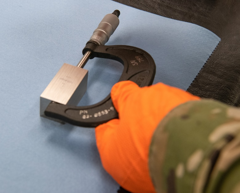 Staff Sgt. Jordan Barker, 56th Component Maintenance Squadron precision measurement equipment lab technician, calibrates a micrometer July 1, 2021, at Luke Air Force Base, Arizona. A micrometer is a gauge that can make extraordinarily precise measurements within 1/1000 of an inch. Exact measurements are necessary because imprecise calibrations of even the smallest of spaces between objects can lead to catastrophic malfunctions. PMEL technicians ensure accurately calibrated equipment to support the needs of the Air Force, sister services and allied forces.