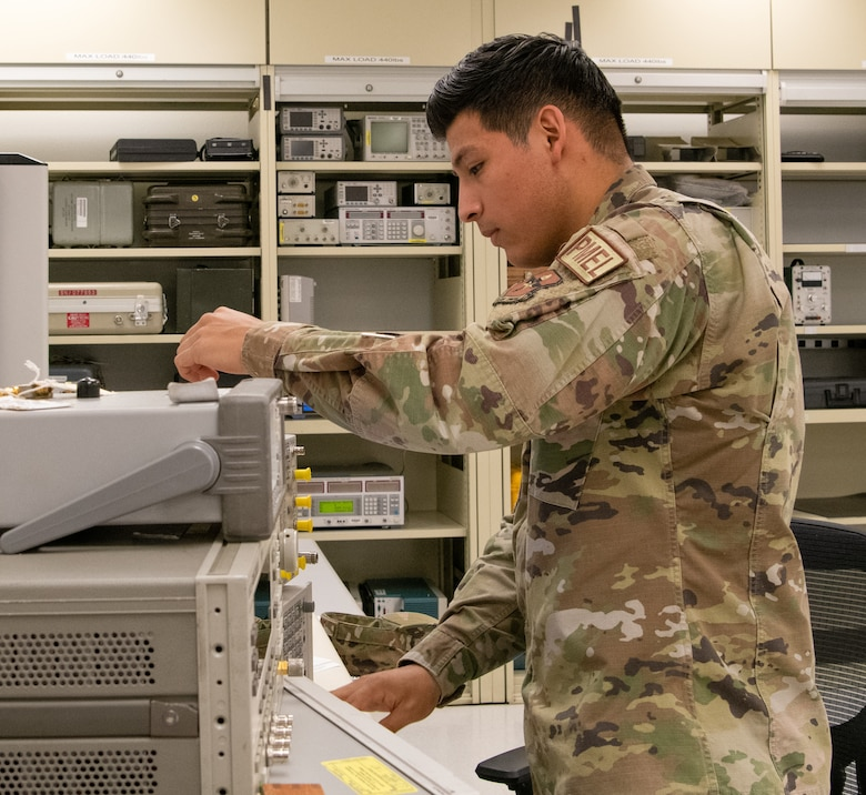 Staff Sgt. Vicente Jimenez, 56th Component Maintenance Squadron precision measurement equipment lab technician, calibrates a spectrum analyzer July 1, 2021, at Luke Air Force Base, Arizona. The spectrum analyzer is used to measure the power of a signal's various frequency components. PMEL technicians ensure accurately calibrated equipment to support the needs of the Air Force, sister services and allied forces.