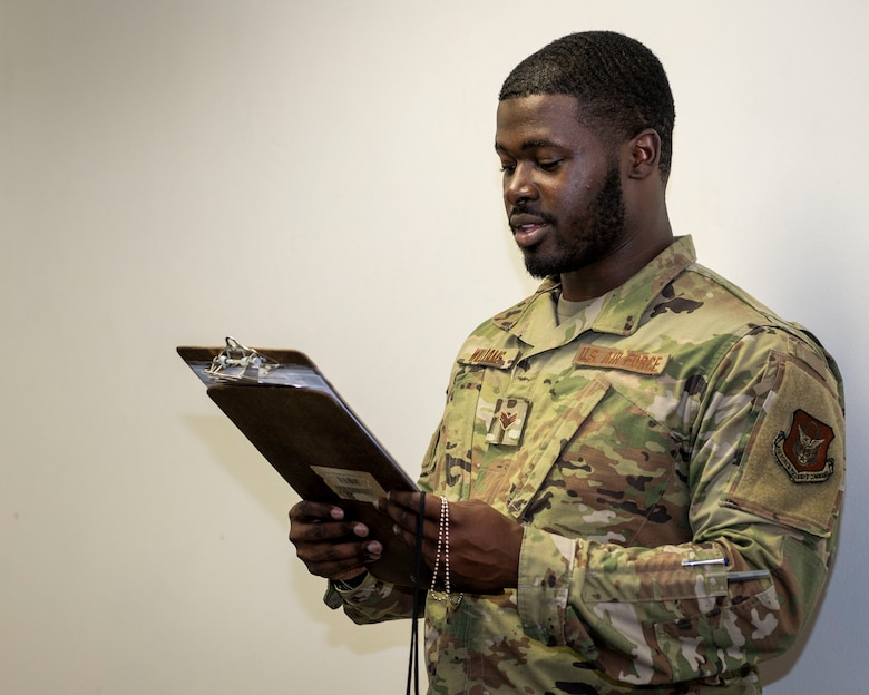 Senior Airman Darius Williams, 916th FSS FAC technician, reads the fitness assessment guidelines at Seymour Johnson Air Force Base, North Carolina, July 15, 2021.