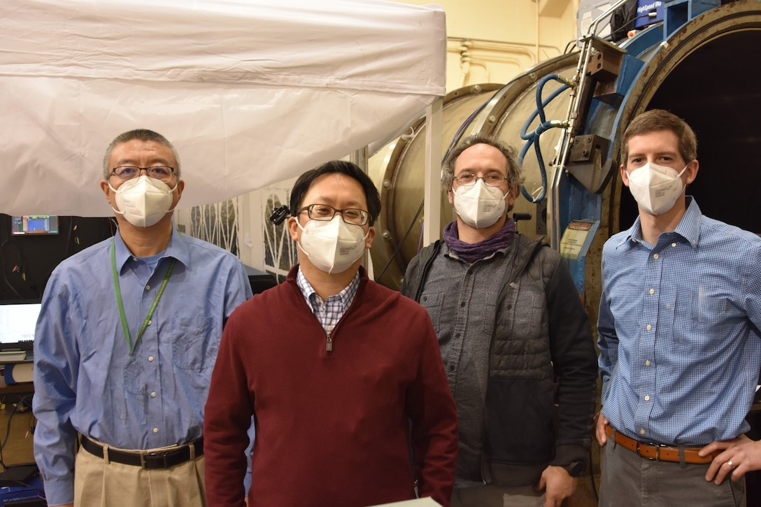 Personnel with Spectral Energies, LLC are pictured at Arnold Engineering Development Complex Hypervelocity Wind Tunnel 9 in White Oak, Maryland. A Small Business Innovation Research program funded to Spectral Energies allowed a previously-demonstrated diagnostic used to measure velocities within hypersonic wind tunnels to be performed at an increased data rate. The SBIR project was successfully demonstrated at Tunnel 9. Pictured from left are Dr. Naibo Jiang, Dr. Paul Hsu, Dr. Mikhail Slipchenko and Dr. Steven Grib. (U.S. Air Force photo)