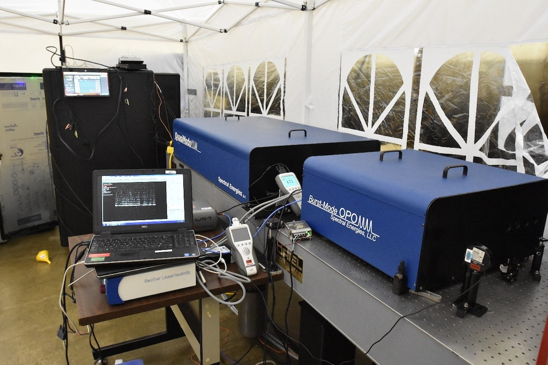 Pictured is the setup of the 100 kHz burst-mode laser-based KTV system, which includes the high-energy burst-mode laser and high-speed Optical Parametric Oscillator. The OPO was developed by Spectral Energies, LLC as part of a Small Business Innovation Research project funded to the company to look into increasing the data rates for the measurement of velocities in hypersonic wind tunnels. The SBIR project was successfully demonstrated at Arnold Engineering Development Complex Hypervelocity Wind Tunnel 9. (U.S. Air Force photo)