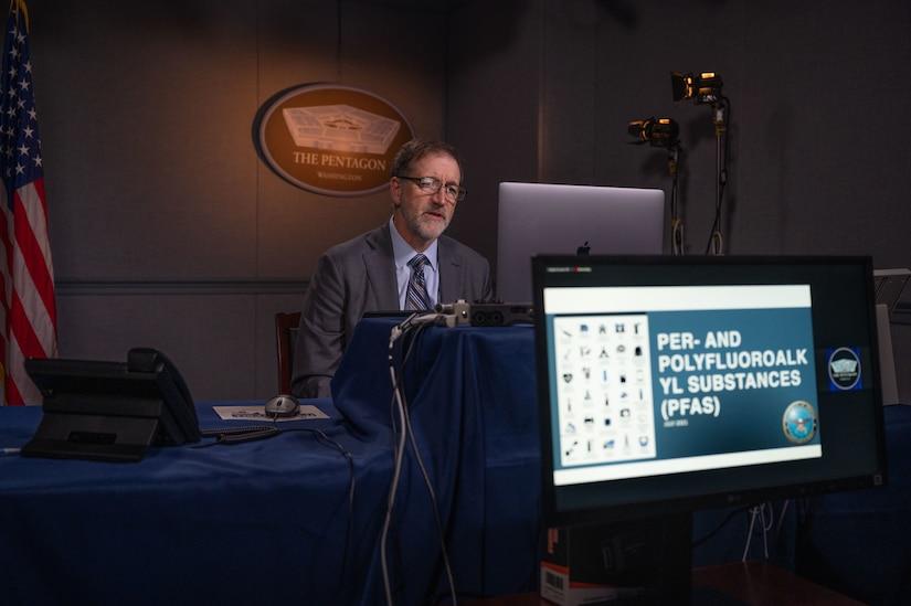 A man sits behind a laptop during an online presentation.