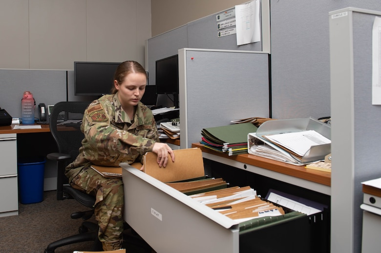 A photo of an Airman filing documents.