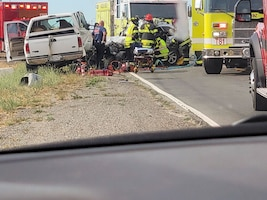 Paramedics tend to a car crash.