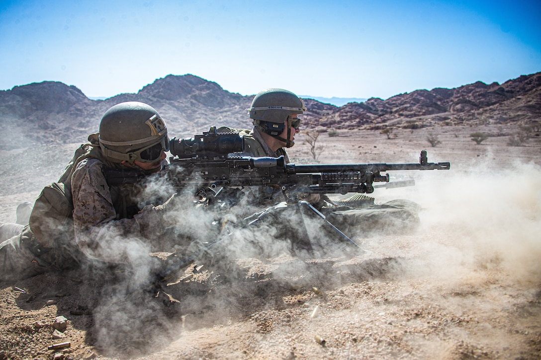 U.S. Marines with 2nd battalion, 1st Marines, assigned to Special Purpose Marine Air-Ground Task Force – Crisis Response – Central Command fire a M240B medium machine gun while training in Jordan, June 23, 2021. SPMAGTF-CR-CC is designed to respond rapidly and efficiently to a wide-range of military operations utilizing aviation, ground, and logistics assets.