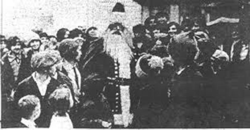 Brig. Gen. J. Tandy Ellis, Kentucky's 26th Adjutant General, dresses as Santa Claus for a crowd, 1926.