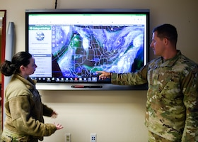 Staff Sgt. Craig Cassell, 56th Operations Support Squadron weather flight shift supervisor, and Senior Airman Breanna Hawkins, 56th OSS weather flight journeyman, observe weather patterns impacting the southwest United States June 15th, 2021, at Luke Air Force Base, Arizona.