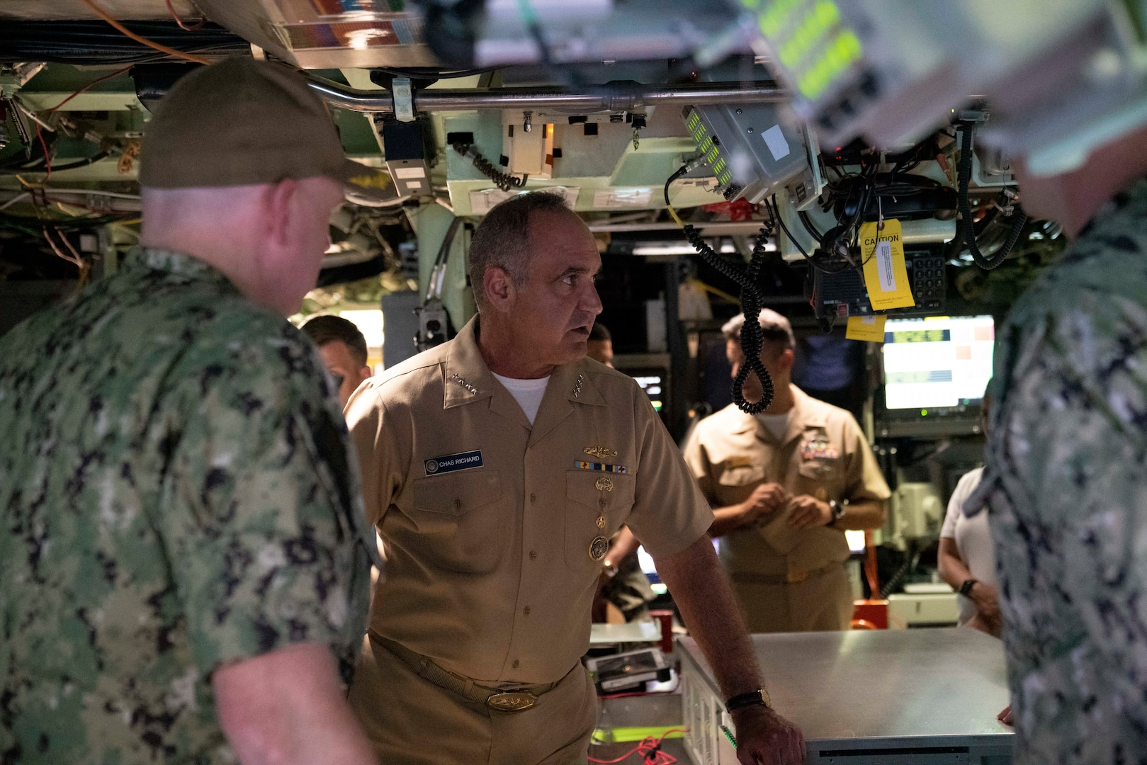 Admiral Chas Richard, Commander, United States Strategic Command, receives a brief in the control room of the Virginia-class fast-attack submarine USS Illinois (SSN 786). Richard visited commands on Guam to see how they fit into the USSTRATCOM mission of deterring strategic attack and employing forces, as directed, to guarantee the security of the nation and its allies.