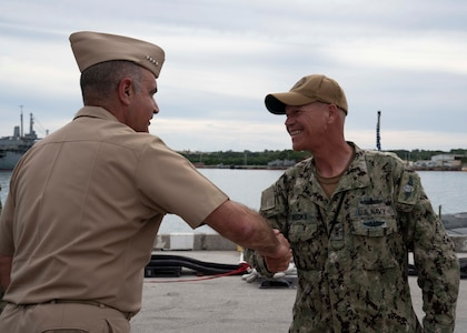 Admiral Chas Richard, Commander, United States Strategic Command, shakes hands with Chief Warrant Officer Barron Brooks following a tour of the Virginia-class fast-attack submarine USS Illinois (SSN 786). Richard visited commands on Guam to see how they fit into the USSTRATCOM mission of deterring strategic attack and employing forces, as directed, to guarantee the security of the nation and its allies.