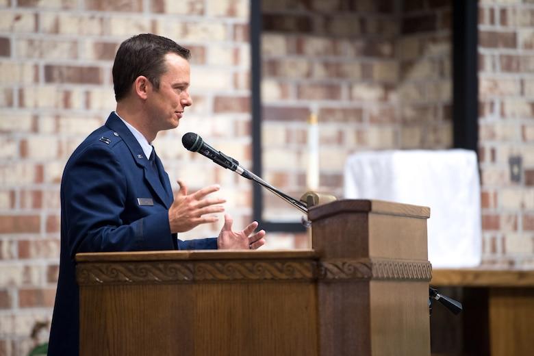 Photo of Airman speaking at podium