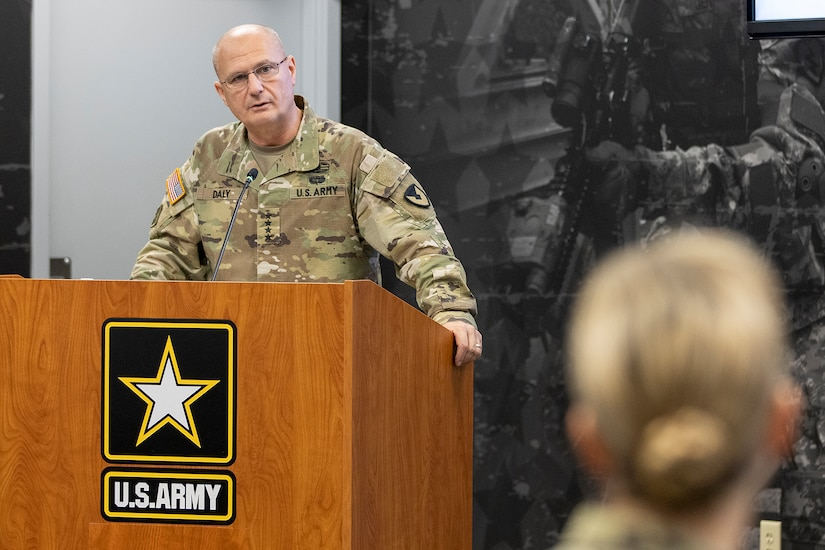 Gen. Edward M. Daly, U.S. Army Materiel Command commanding general, speaks to Col. Paige M. Jennings, U.S. Army Financial Management Command commander, shortly after Jennings assumed command at the Maj. Gen. Emmett J. Bean Federal Center in Indianapolis July 15, 2021. USAFMCOM enables the readiness of America's Army by serving as the focal point for all finance and comptroller operations while providing capabilities that facilitate accountability, auditability and stewardship. (U.S. Army photo by Mark R. W. Orders-Woempner)