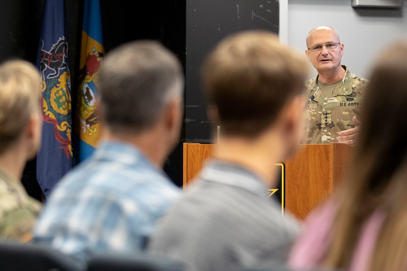 Gen. Edward M. Daly, U.S. Army Materiel Command commanding general, speaks to Col. Paige M. Jennings, U.S. Army Financial Management Command commander, and her family shortly after Jennings assumed command at the Maj. Gen. Emmett J. Bean Federal Center in Indianapolis July 15, 2021. USAFMCOM enables the readiness of America's Army by serving as the focal point for all finance and comptroller operations while providing capabilities that facilitate accountability, auditability and stewardship. (U.S. Army photo by Mark R. W. Orders-Woempner)