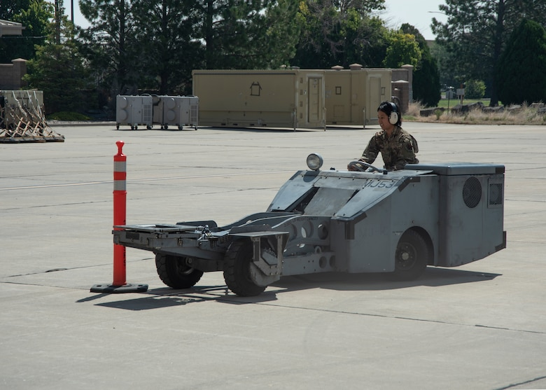 An Airman drives a jammer vehicle between cones.