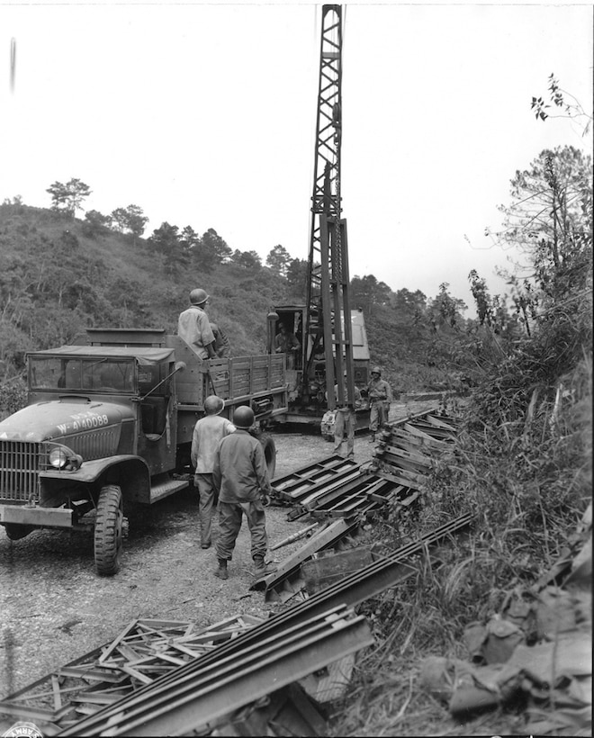 Soldiers from the 117th Engineer Battalion, 37th Infantry Division construct a Bailey Bridge across the 125-foot span over the Irisan River on Highway 9, near Baguio, Luzon, Philippine Islands, April 22, 1945. (Photo from Maj. Gen. Robert S. Beightler Audiovisual Collection/Ohio History Connection)