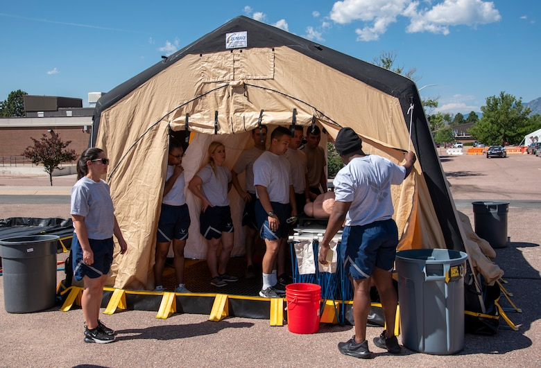 Airmen learn decontamination before exercise