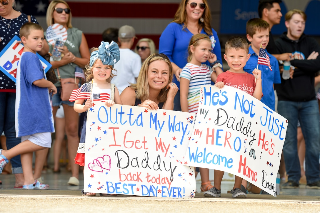 """Friends and family of U.S. Air Force personnel recently deployed to Prince Sultan Air Base, Kingdom of Saudi Arabia, gather to celebrate their return home July 18, 2021 to the 169th Fighter Wing at McEntire Joint National Guard Base, South Carolina. """"Swamp Fox"""" Airmen from the South Carolina Air National Guard's 169th Fighter Wing were deployed to PSAB for the past three months to project combat power and help bolster defensive capabilities against potential threats in the region. (U.S. Air National Guard photo by Tech. Sgt. Megan Floyd, 169th Fighter Wing Public Affairs)"""