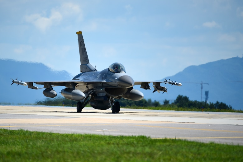 An F-16 Fighting Falcon taxis at Kunsan Air Base, Republic of Korea, July 16, 2021. The last of the 8th Fighter Wing jets returned home after supporting a month-long multinational training event at Red Flag-Alaska 21-2, while practicing Agile Combat Employment tactics. (U.S. Air Force photo by Senior Airman Suzie Plotnikov)