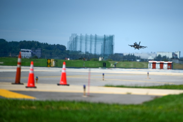 An F-16 Fighting Falcon lands on the flightline at Kunsan Air Base, Republic of Korea, July 15, 2021. The last of the 8th Fighter Wing jets returned home after supporting a month-long multinational training event at Red Flag-Alaska 21-2, while practicing Agile Combat Employment tactics. (U.S. Air Force photo by Senior Airman Suzie Plotnikov)