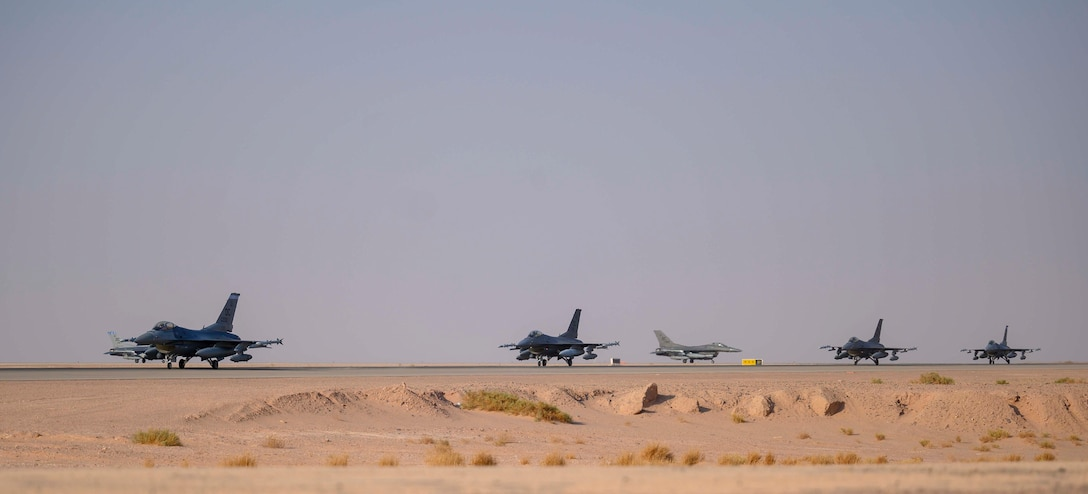 """Several U.S. Air Force F-16C Fighting Falcons from District of Columbia Air National Guard's 113th Wing, known as the """"Capital Guardians,"""" taxi on the flight line upon arrival at Prince Sultan Air Base, Kingdom of Saudi Arabia, July 9, 2021. The wing deployed a contingent of F-16s to PSAB to reinforce the base's defensive capabilities, provide operational depth, and support U.S. Central Command operations in the region. (U.S. Air Force Photo by Senior Airman Samuel Earick)"""