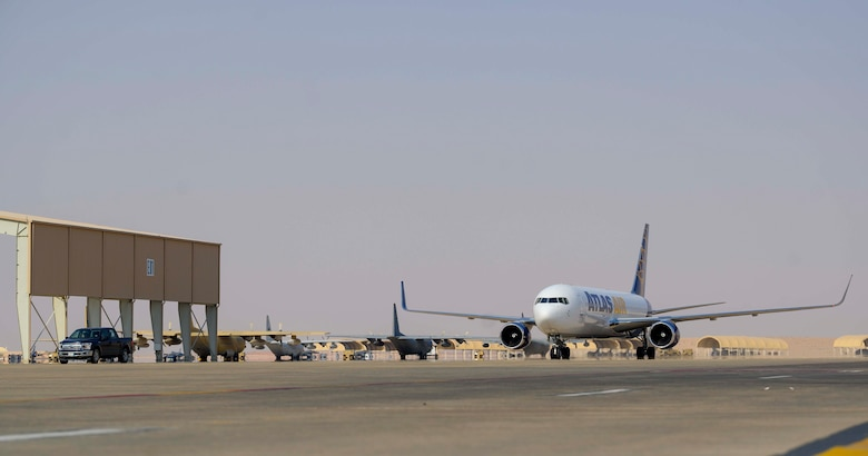 """An aircraft carrying members of the District of Columbia Air National Guard's 113th Wing, known as the """"Capital Guardians,"""" taxis on the flight line upon arrival at Prince Sultan Air Base, Kingdom of Saudi Arabia, July 11, 2021. The wing deployed a contingent of U.S. Air Force F-16 Fighting Falcons to PSAB to reinforce the base's defensive capabilities, provide operational depth, and support U.S. Central Command operations in the region. (U.S. Air Force Photo by Senior Airman Samuel Earick)"""