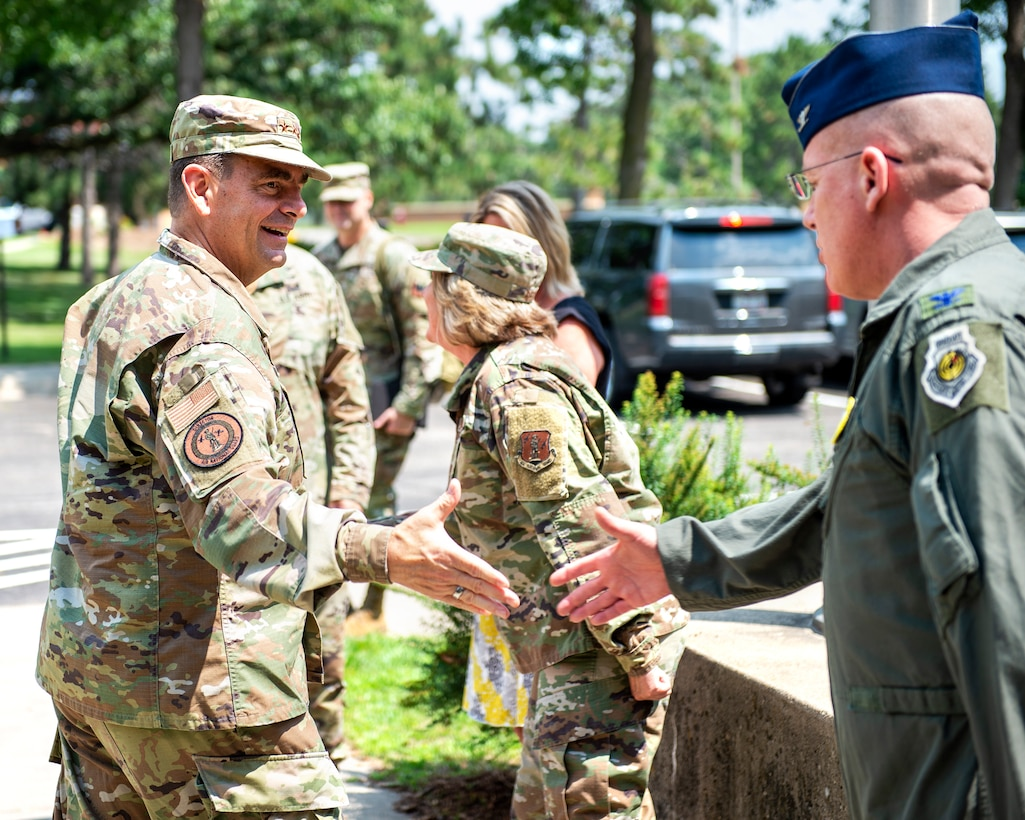 U.S. Air Force Lt. Gen. Michael A. Loh, Director of the Air National Guard, is greeted by Col. James D. Cleet, Commander of the 133rd Airlift Wing, and other senior leaders from the Minnesota National Guard in St. Paul, Minn., July 16, 2021