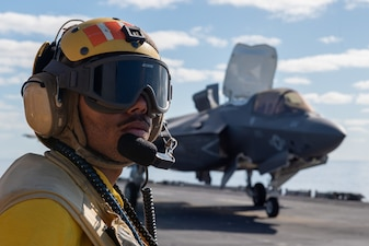 Aviation Boatswain's Mate (Handling) Airman Micah Callwood, from New Haven, Conn., assigned to the forward-deployed amphibious assault ship USS America (LHA 6), conducts flight operations during Exercise Talisman Sabre 21.