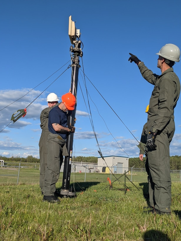 Members of the Maine Air National Guard's 265th Combat Communications Squadron install communications equipment in support of Exercise Amalgam Dart at Canadian Forces Base Cold Lake in Alberta on June 12, 2021.
