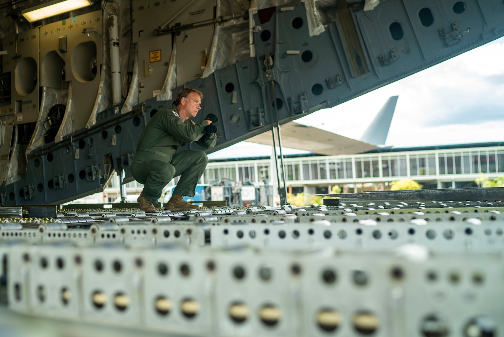 Master Sgt. Don Rix, 701st Airlift Squadron loadmaster, directs a forklift at Johan Adolf Pengel International Airport, Suriname, July 16, 2021.